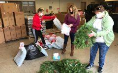 Kaylyn Marsh, Ms. Baker, and Ms. Prifogle sorting wreaths.