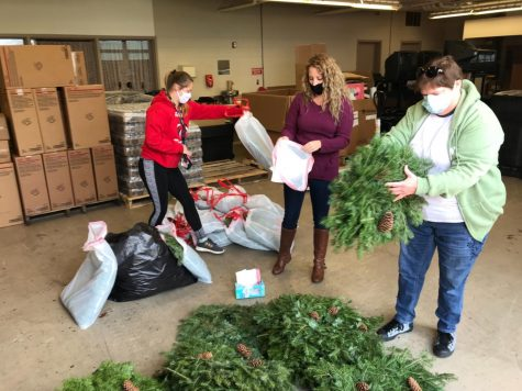 Kaylyn Marsh, Ms. Baker, and Ms. Prifogle sorting wreaths.