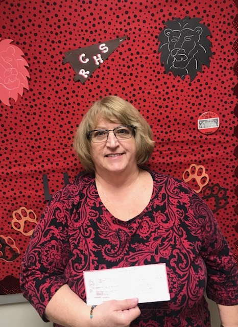 Mrs. Gray with donation check